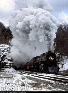Exiting Nay Augh Tunnel. February, 1996 Steamtown NP borrowed the Milwaukee Road 261  for a series of excursions, including a winter railfan weekend. Scranton, PA. Photo by Cascade Bruce.