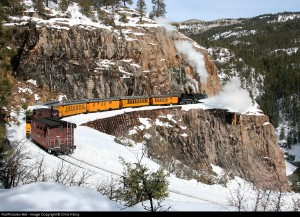 Set against a backdrop of rocky cliffs, the Animas River far below, and snow depths not seen in the past 15 years in southwestern Colorado, K-28 #478 blows down as she slowly makes her way north around the famous horseshoe curve on the Durango & Silverton Narrow Gauge Railroad High Line. Photo by Chris Kilroy. 2/10/08.