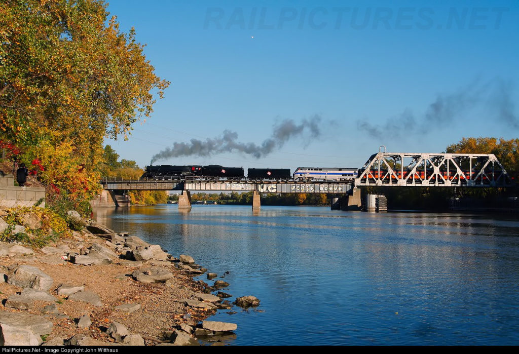After making it's last passenger pick up, Milwaukee 261 highballs Minneapolis, westward on the Fall Colors Special. The train is crossing the bridge that takes the Wayzata Sub across Boom Island in the historic section of downtown. Photo by John Witthaus. 10/11/15